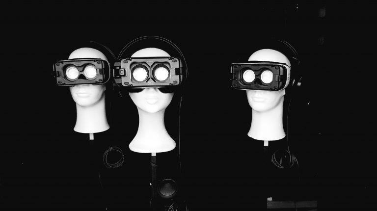 three styrofoam heads with empty VR glasses